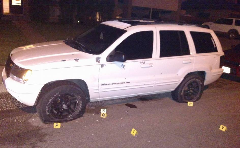 Officers found a white Jeep Cherokee with more than a dozen bullet holes on the driver's side; the front and rear driver's-side tires had also been shot.