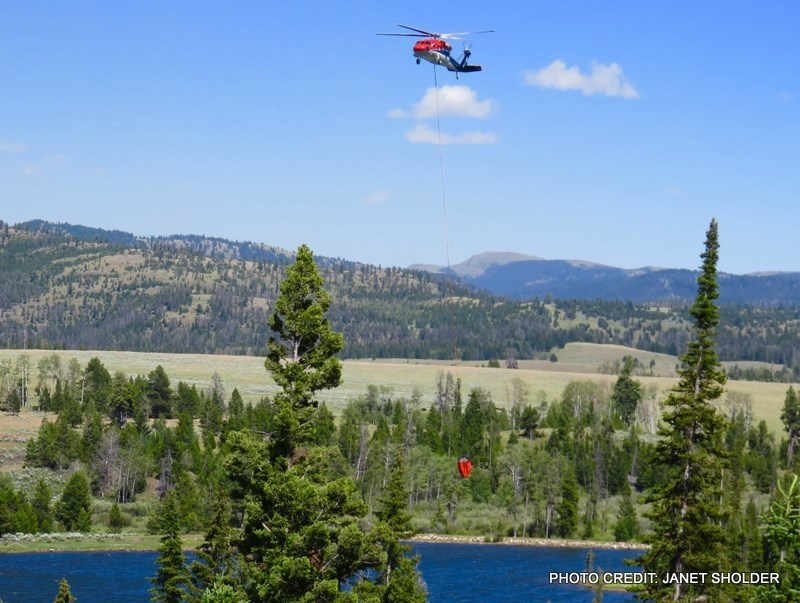 A DNRC helicopter is making water-bucket drops from nearby Krohn Lake.