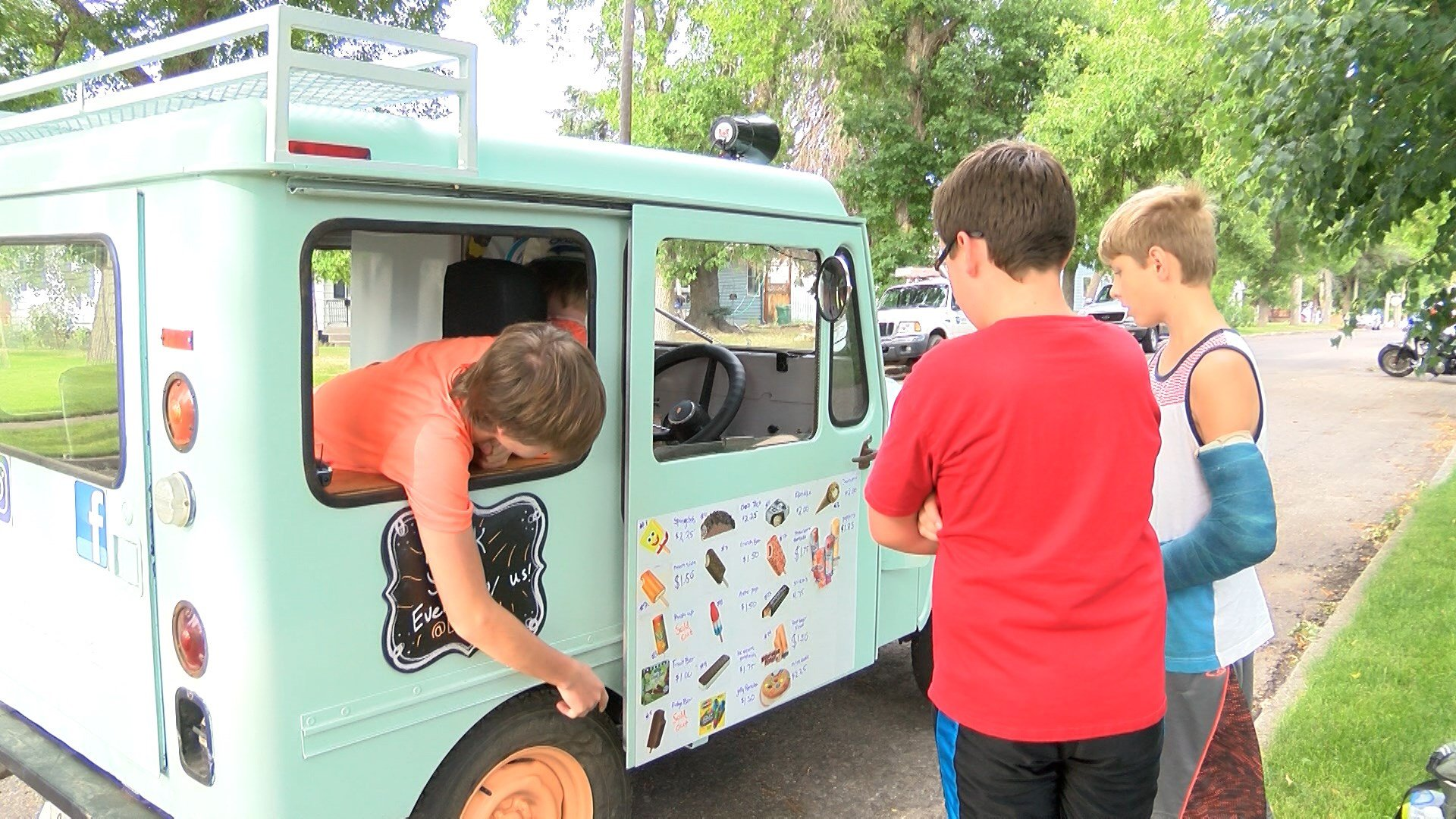 Aiden and Mitchell Heffernan say the family purchased an old mail truck and restored it into an ice cream Jeep.