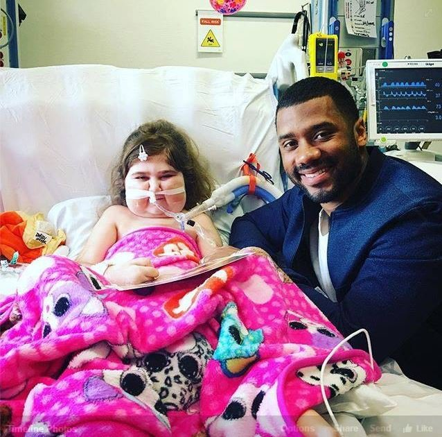 Russell Wilson visits eight year old Daisy Hader in Seattle