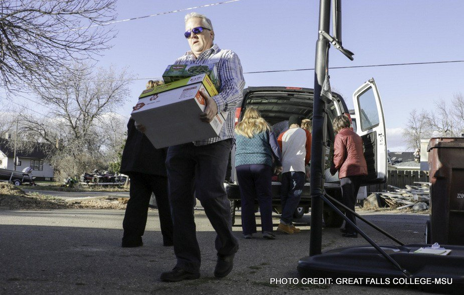 John Lynn, GFC MSU Assistive Technology Specialist, unloads donations at the Grace Home.