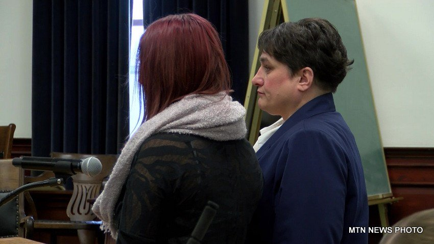 Katelyn Craft (wearing scarf) with her attorney