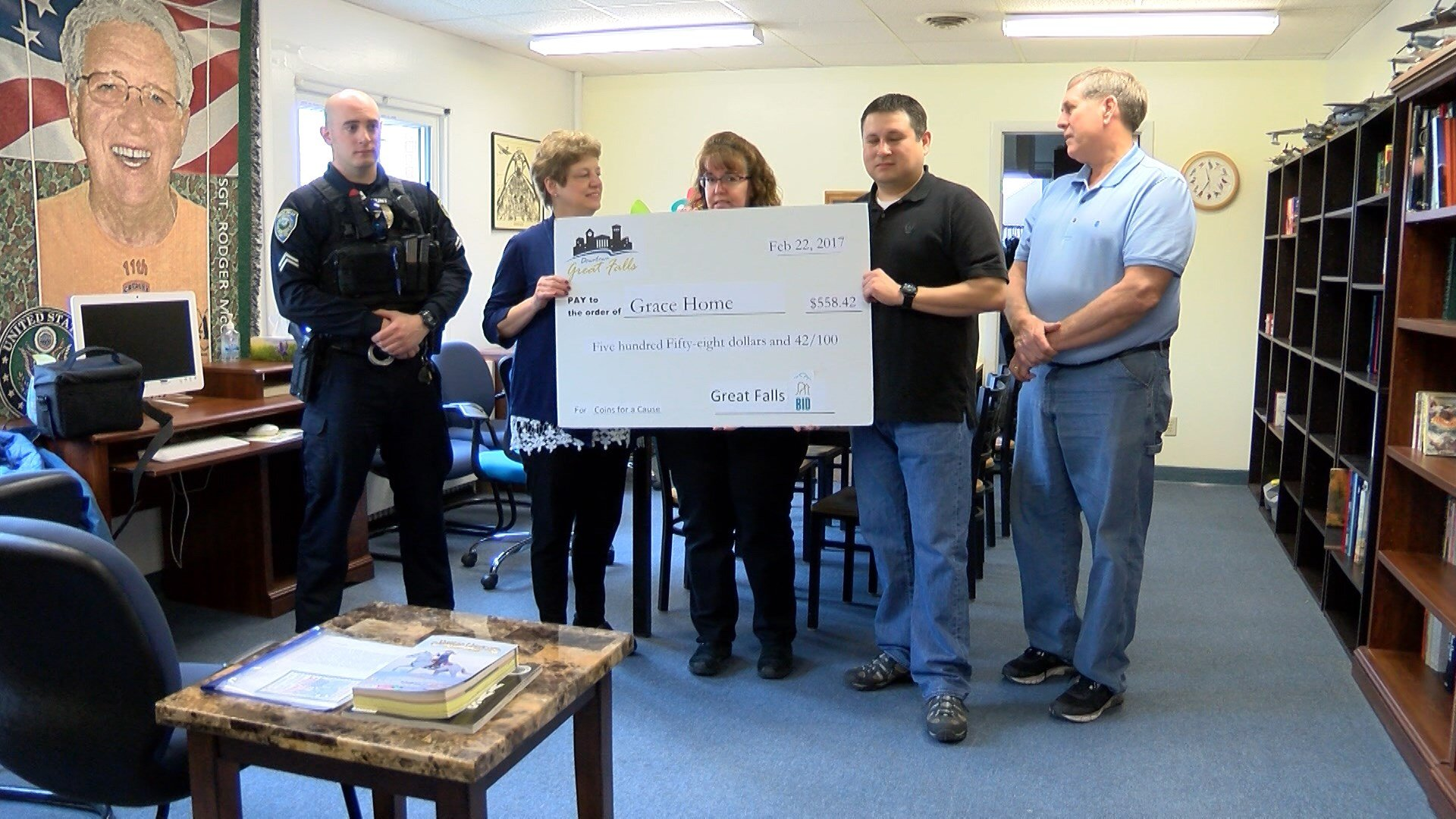 The Downtown Safety Alliance presented the Grace Home Veteran's Center, which helps homeless veterans, a check for $558.42 Wednesday.
