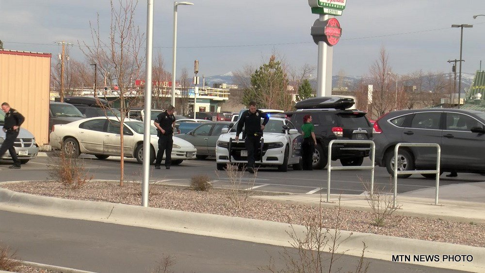 Missoula Police Department spokesman Sgt. Travis Welsh says the incident began as a disagreement between three people in two vehicles.
