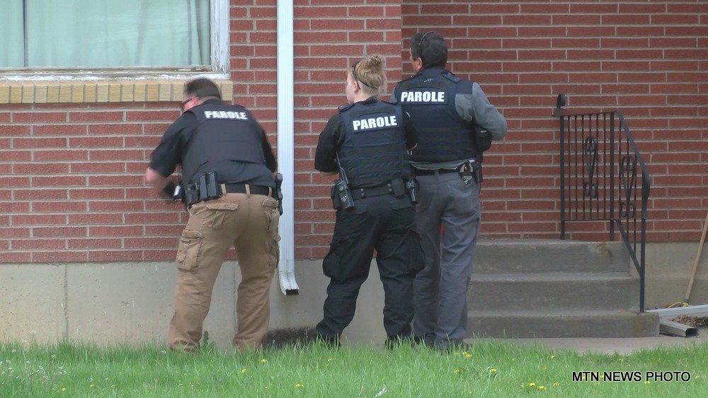 "After several hours, police used several ""flash-bang"" devices and a battering ram to get into the house."