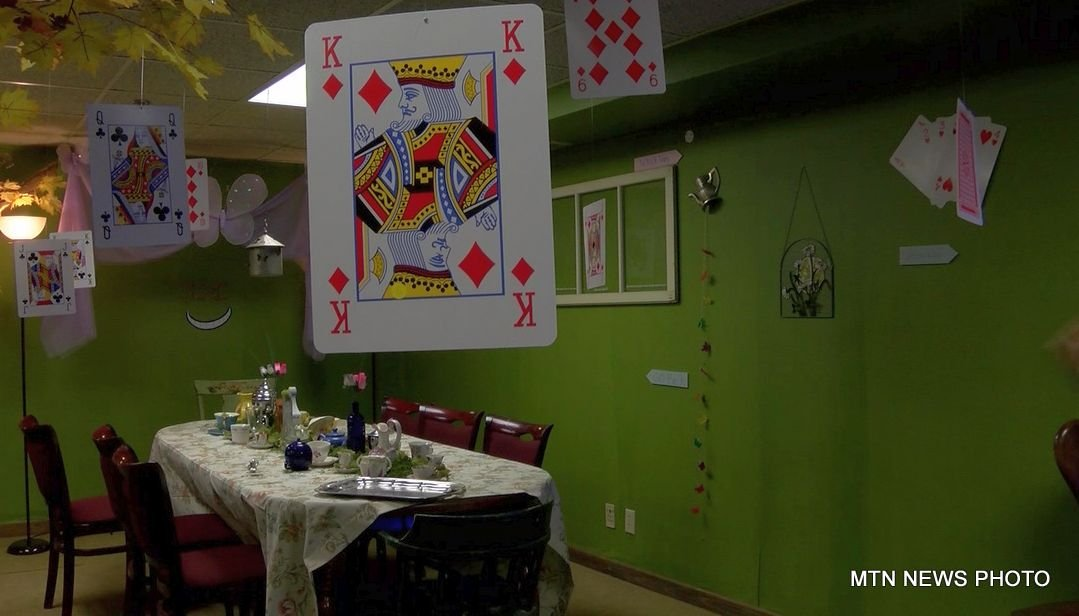 "Bostick says they came up with the ""Alice in Wonderland"" themed room after throwing around several other ideas."