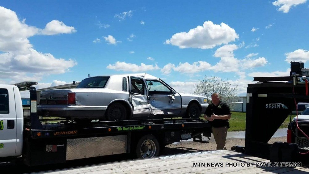 The suspect vehicle, which had significant damage to its side
