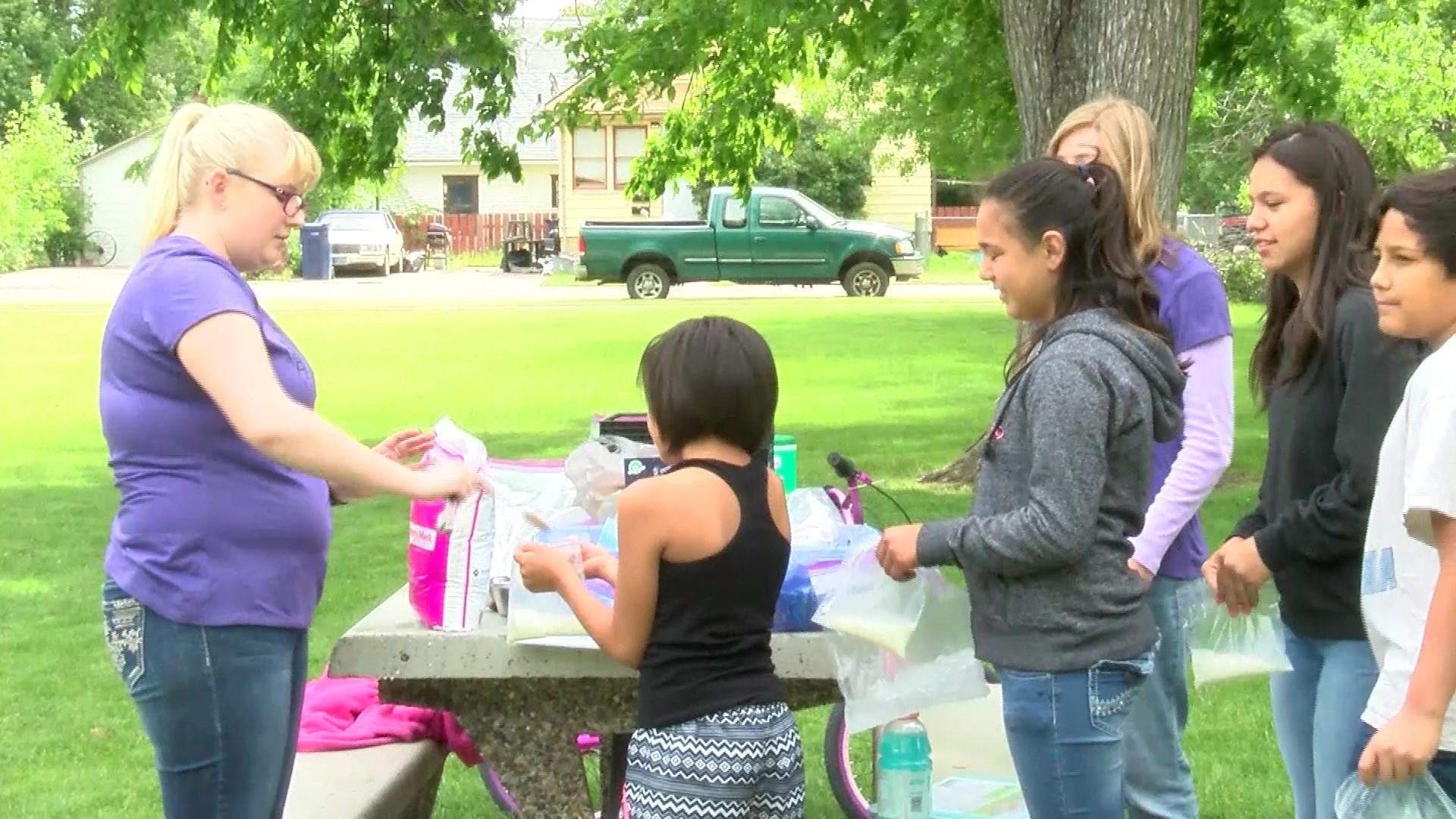 Kids in Rhodes Park on Friday were making ice cream.