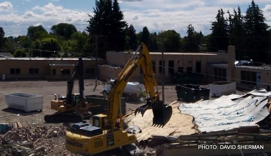 Demolition of the old Lowell Elementary School in Great Falls got underway on Monday.
