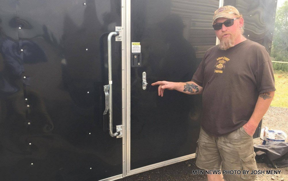 Leo Curtis shows the cargo trailer that contained the stolen items