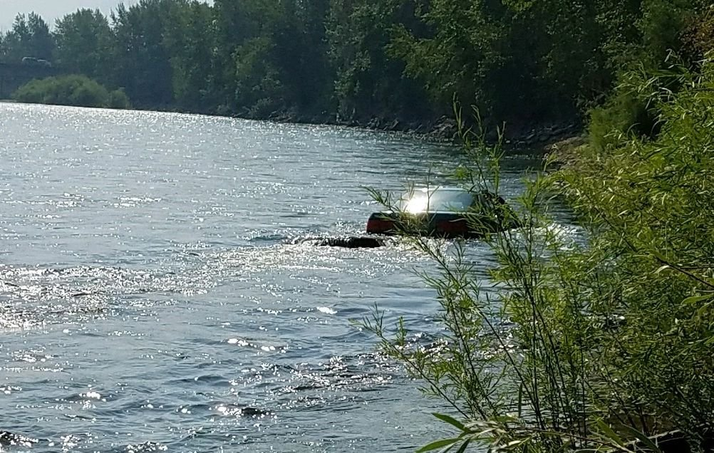 The chase ended with the car in the Clark Fork River. (MTN News/Russ Thomas photo)