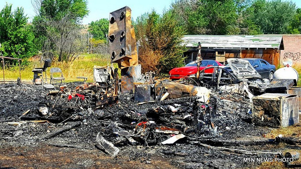 The Lodge Grass house where three people were shot and killed last week was destroyed in a fire early Tuesday.