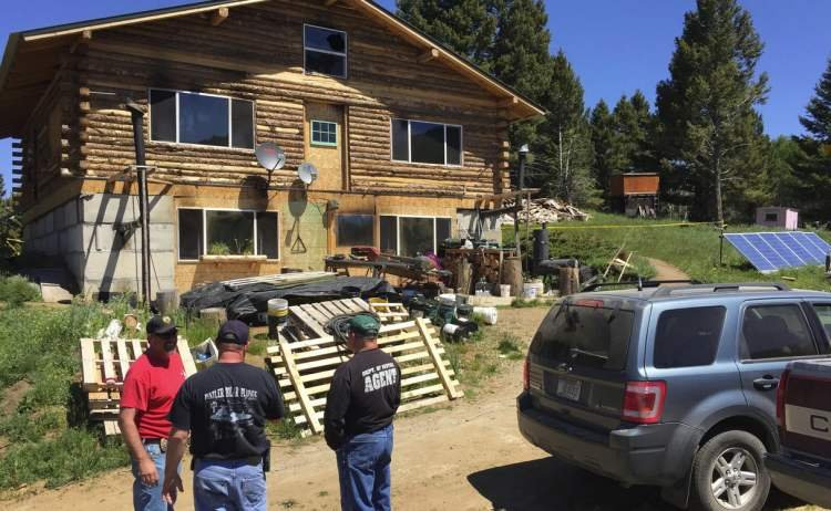 Anaconda police gather outside the home southeast of Deer Lodge that was the scene where a man shot his wife and children before killing himself Sunday (Photo: John Emeigh-MTN News)