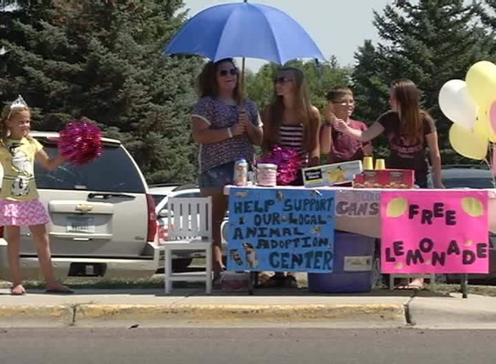 Jovie Street of Great Falls, 7 years old, set up a lemonade stand at the corner of Fox Farm and Park Garden Road on Tuesday. (MTN News photo)