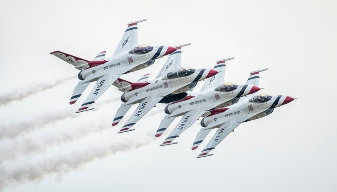 The Thunderbirds Diamond formation performs the echelon pass in review maneuver during the Joint Base San Antonio Air Show, Oct. 31, 2015, at JBSA, TX. (U.S. Air Force photo by Senior SrA Rachel Maxwell)